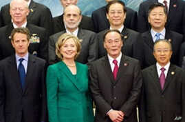 Chinese Vice-Premier Wang Qishan (2nd R) stands alongside Chinese State Councilor Dai Bingguo (1st R), U.S. Secretary of State Hillary Clinton (2nd L) and U.S. Secretary of Treasury Timothy Geithner (1st L) at the Great Hall of the People in Beijing,