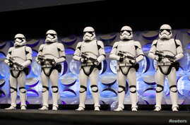 Redesigned stormtroopers appear onstage at the kick-off event of the Star Wars Celebration convention in Anaheim, California, April 16, 2015.