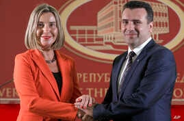 European Union High Representative for Foreign Affairs and Security Policy Federica Mogherini, left, and Macedonian Prime Minister Zoran Zaev pose for a photo, following their meeting at the government building in Skopje, Macedonia, April 18, 2018.