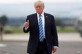 President Donald Trump gives a thumbs-up as walks to board on Air Force One at Hagerstown Regional Airport in Hagerstown, Md., Friday, Aug. 18, 2017, following a national security meeting at Camp David.