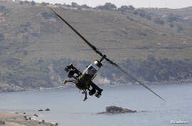 FILE - A Turkish Cobra military helicopter flies during an exercise in Izmir, May 26, 2010.