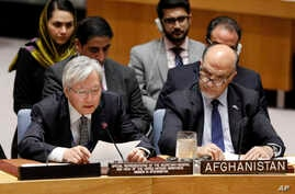 United Nations envoy for Afghanistan Tadamichi Yamamoto, left, addresses the United Nations Security Council, at U.N. headquarters, Monday, Sept. 17, 2018.