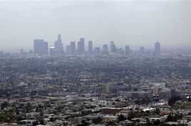 FILE - EPA officials set to announce new standards on Friday; above, smog covers downtown Los Angeles, Calif., April 2009.