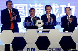 (L-R) FIFA Marketing Director Thierry Weil, FIFA Vice-President David Chung, the chairman of Dalian Wanda Group in China Wang Jianlin and the first vice president of the Football Association of the People's Republic of China Zhang Jian attend an even