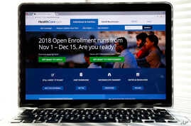 FILE - The Healthcare.gov website is seen on a computer screen in Washington, Oct. 18, 2017. The government says about 8.8 million people have signed up for coverage next year under the Affordable Care Act.
