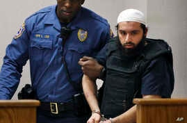 FILE - In this Dec. 20, 2016, photo, Ahmad Khan Rahimi,, is led into court in Elizabeth, New Jersey.