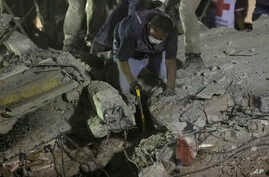 Rescue workers search for people trapped in a collapsed building in the Piedad Narvarte neighborhood of Mexico City, Tuesday, Sept. 19, 2017.