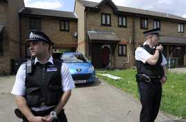 Police officers outside home raided n Stratford, east London, July 5, 2012.