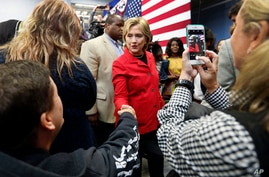 Democratic presidential candidate Hillary Rodham Clinton campaigns during a campaign stop at the Manchester Community College in Manchester, New Hampshire, Oct. 5, 2015.