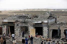 People gather at the site of Saudi-led air strikes in Arhab area, around 20 kilometres (13 miles) north of Sana'a, Aug. 23, 2017.