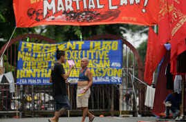 Filipino activists protest near the Malacanang Presidential Palace in Manila, Philippines, July 20, 2017, against Philippine President Rodrigo Duterte's proposed extension of martial law in the whole of Mindanao island until the end of the year.