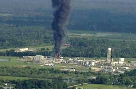 Smoke rises from a chemical plant in Crosby, near Houston, Texas, Sept. 1, 2017. Thick black smoke and towering orange flames shot up Friday from the flooded Houston-area chemical plant after two trailers of highly unstable compounds blew up a day ea