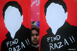 A demonstrator holds placards calling for the release of Raza Mehmood Khan, a member of Aghaz-i-Dosti (Start of Friendship), during a protest in Lahore, Pakistan, Dec. 11, 2017. Kahn resurfaced last week in Lahore.