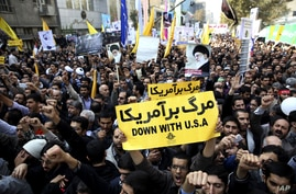 Iranian protesters chant slogans during an anti-American rally in Tehran, Iran,  Nov. 4, 2013.