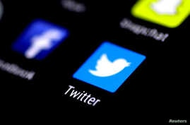 FILE - The Twitter application is seen on a phone screen.
