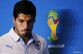 Uruguay's national soccer team player Luis Suarez attends a news conference prior a training session at the Dunas Arena soccer stadium in Natal, June 23, 2014.