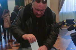 Gerard Depardieu votes at the Embassy of Russia in Paris, France, March 18, 2018 in this picture obtained from social media.