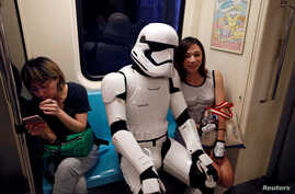 """A fan dressed as a Storm Trooper from """"Star Wars"""" reacts at the Taipei Metro (MRT) during Star Wars Day in Taipei, Taiwan, May 4, 2017."""