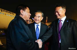 Wang Yi welcomes Duterte