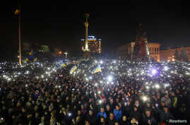 Anti-government protesters light torches and mobile devices during a rally in Independence Square in Kyiv, Ukraine, Feb. 21, 2014.