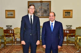 In this photo provided by Egypt's state news agency, MENA, Egypt's President Abdel-Fattah el-Sissi, right, poses for a photo with White House adviser Jared Kushner, in Cairo, Egypt, Wednesday, Aug. 23, 2017.