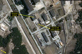 In this image provided by 38 North, shows a rail flatcar at radiochemical laboratory where North Korea separates weapons-grade plutonium from waste from a nuclear reactor. U.S. researchers see further signs from satellite imagery that North Korea is