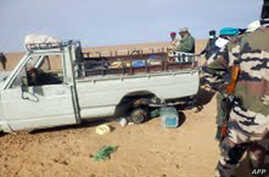 A picture taken with a mobile phone Oct. 30, 2013 and received on Nov. 2, 2013 shows one of the trucks that was carrying some of 92 migrants who died of thirst in the harsh Niger desert, about a dozen kilometers from the Algerian border.