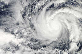 Typhoon Hagupit in the western Pacific Ocean is captured by NASA's Aqua satellite, December 3, 2014.