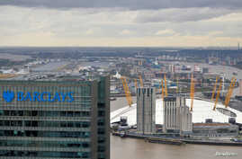FILE - A Barclays bank building is seen at Canary Wharf in London, Britain, Oct. 19, 2016.
