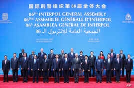 Chinese President Xi Jinping stands with Secretary General Interpol Jurgen Stock, center, right, and Meng Hongwei, center left, president of Interpol, pose for a group photo at the 86th Interpol General Assembly at Beijing National Convention Center,