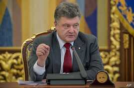 Ukrainian President Petro Poroshenko speaks at the Security Council meeting in Kiev, Ukraine, Thursday, July 17, 2014. Ukrainian President Petro Poroshenko called the downing of a Malaysia Airlines passenger plane an act of terrorism and called for a