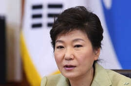 South Korean President Park Geun-hye speaks during a Cabinet Council meeting at the presidential Blue House in Seoul, South Korea, Tuesday, Dec. 10, 2013.