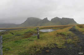 FILE - Iceland's desolate landscape stretches beyond Vik, a small town of just 300 people, towards the Katla volcano, unseen,which last erupted in 1918, in this Sept. 27, 2011 photo.