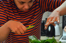 Developmentally-disabled residents of group homes in Maryland help prepare the fresh vegetables - from Red Wiggler Farm - for dinner.