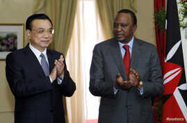 Chinese Premier Li Keqiang and Kenya's President Uhuru Kenyatta applaaChinese Premier Li Keqiang and Kenya's President Uhuru Kenyatta applaud the signing of the Standard Gauge Railway agreement at the State House in Nairobi, May 11, 2014.