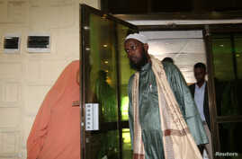FILE - A former top leader of al-Shabaab, Mukhtar Robow, arrives for a news conference in Mogadishu, Somalia, Aug. 15, 2017. Robow has condemned Saturdays's bombing attack in Mogadishu which has claimed at least 276 lives.