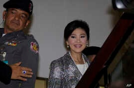 Thailand's former Prime Minister Yingluck Shinawatra, arrives at parliament in Bangkok, Thailand Thursday, Jan. 22, 2015.