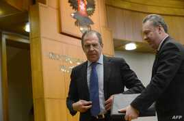 FILE - Russian Foreign Minister Sergei Lavrov, left, speaks with Foreign Ministry spokesman Alexander Lukashevich after holding his traditional start-of-year press conference in Moscow, Jan. 23, 2013.