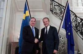Swedish Prime Minister Stefan Lofven, left, welcomes President of the European Council Donald Tusk at his official residence in Stockholm, Oct. 9, 2017, for a dinner ahead of next week's EU summit.