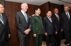 U.S. Defense Secretary Jim Mattis (2nd-L) laughs with Southeast Asian defense ministers after their meeting at the 17th International Institute for Strategic Studies (IISS) Shangri-la Dialogue, an annual defense and security forum in Asia, in Singapo