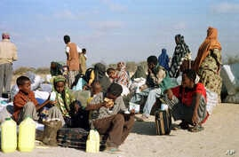 FILE - Somali refugees wait for a plane to take them home from Dabaab refugee camp in northern Kenya.