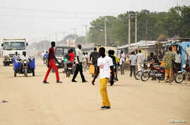South Sudanese residents walk along a street of Bor, in Jonglei state, Dec. 10, 2014.