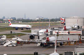 FILE - British Airways planes at Heathrow Terminal 5 in London, Britain, May 27, 2017.