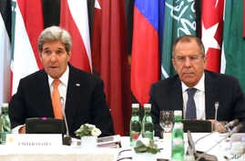 U.S. Secretary of State John Kerry, left, and Russian Foreign Minister Sergey Lavrov confer in Vienna, Austria, Nov. 14, 2015. Foreign ministers from more than a dozen nations are meeting in Vienna seeking to find a way to resolve the conflict in Syr...