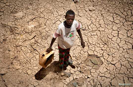 A boy carries a jerrycan in the drought-hit Baligubadle village near Hargeisa, the capital city of Somaliland, in this handout photo provided by The International Federation of Red Cross and Red Crescent Societies on March 15, 2017.