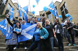 'Yes' campaigners cheer during a rally in Glasgow, Scotland, Sept. 17, 2014.