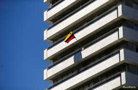 A Venezuelan flag flies on a balcony of the Venezuelan embassy in Madrid, Spain, May 15, 2018.