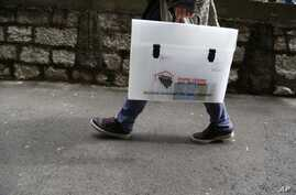 "Bosnian pollster with carrying case labelled ""2013 census, my step into the future,"" Sarajevo, Oct. 1, 2013."