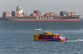 FILE - South Korea's Hanjin Shipping Co. container ship Hanjin Montevideo, top, is anchored outside the Port of Long Beach in Long Beach, Calif.