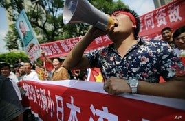 Protesters shout anti-Japan slogans near the Japanese Consulate General in Shanghai, China, September 18, 2012.